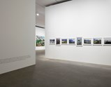 "Installation view of artworks ""Painted Picture of Qinghai - Tibet Railway 1,2, 3, 4"", ""Painted Picture of out of Beichuan 1, 2, 3"", ""Painted Picture of Into Taihu 1"" and ""Time"" of exhibition Liu Xiaodong Painting Shooting"