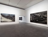 "Installation view of artwork ""This Land is so Rich in Beauty 2"" by Zeng Fanzhi and ""Seeds"" by Zhang Huan of exhibition I Look at Things... 11"