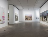"Installation view of artworks ""Hot Bed 2"", ""Out of Beichuan"", ""West"", ""East"", ""The Big Dipper 1"", ""The Ramble of four Men 2"", and ""Qinghai - Tibet Railway"" of exhibition Liu Xiaodong Painting as Shooting"